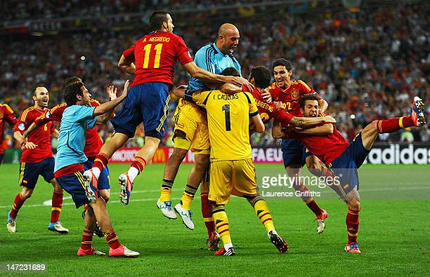 Cesc Fabregas of Spain celebrates scoring the winning penalty with teammates during the UEFA EURO 2012 semi final match between Portugal and Spain at...