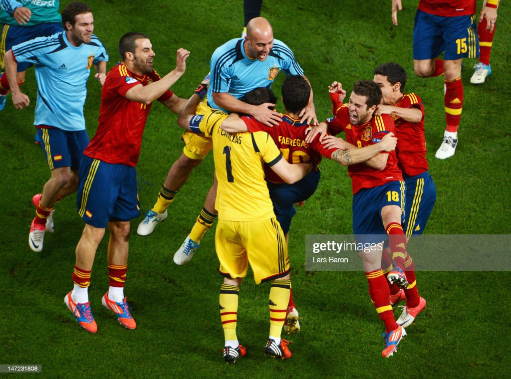 Cesc Fabregas of Spain celebrates scoring the winning penalty with team-mates during the UEFA EURO 2012 semi final match between Portugal and Spain at Donbass Arena on June 27, 2012 in Donetsk, Ukraine.