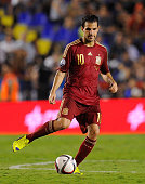 Cesc Fabregas of Spain lays on a pass during the UEFA EURO 2016 Group C Qualifier between Spain and FYR of Macedonia at Estadio Ciutat de Valencia on...