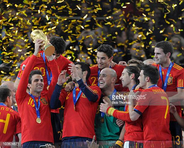 Cesc Fabregas of Spain lifts the trophy and celebrates with teammates after the 2010 FIFA World Cup Final between the Netherlands and Spain on July...