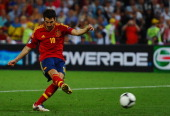Cesc Fabregas of Spain scores the winning penalty during the UEFA EURO 2012 semi final match between Portugal and Spain at Donbass Arena on June 27...