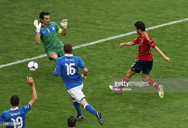 Cesc Fabregas of Spain scores their first goal during the UEFA EURO 2012 group C match between Spain and Italy at The Municipal Stadium on June 10...