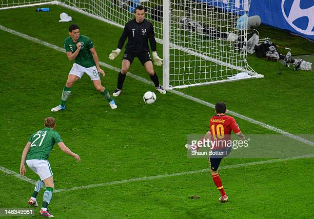 Cesc Fabregas of Spain scores their fourth goal during the UEFA EURO 2012 group C match between Spain and Ireland at The Municipal Stadium on June 14...