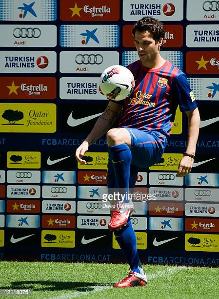 Cesc Fabregas poses for the photographers during his presentation as the new signing for FC Barcelona at Camp Nou sports complex on August 15 2011 in...