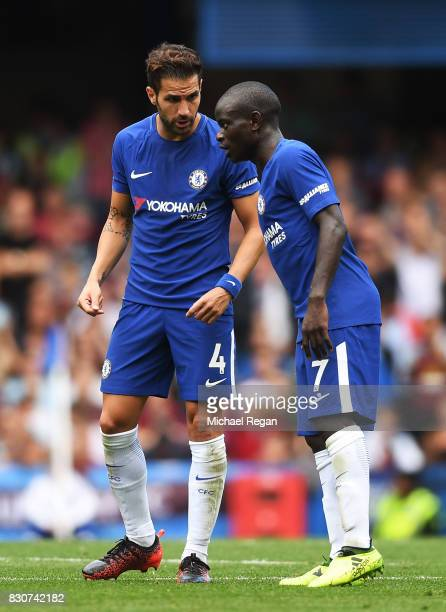 Cesc Fabregas talks with N'Golo Kante of Chelsea during the Premier League match between Chelsea and Burnley at Stamford Bridge on August 12 2017 in...