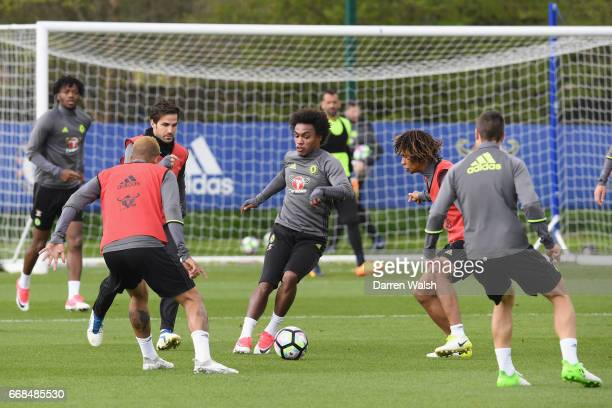 Cesc Fabregas Willian and Nathan Ake of Chelsea during a training session at Chelsea Training Ground on April 14 2017 in Cobham England