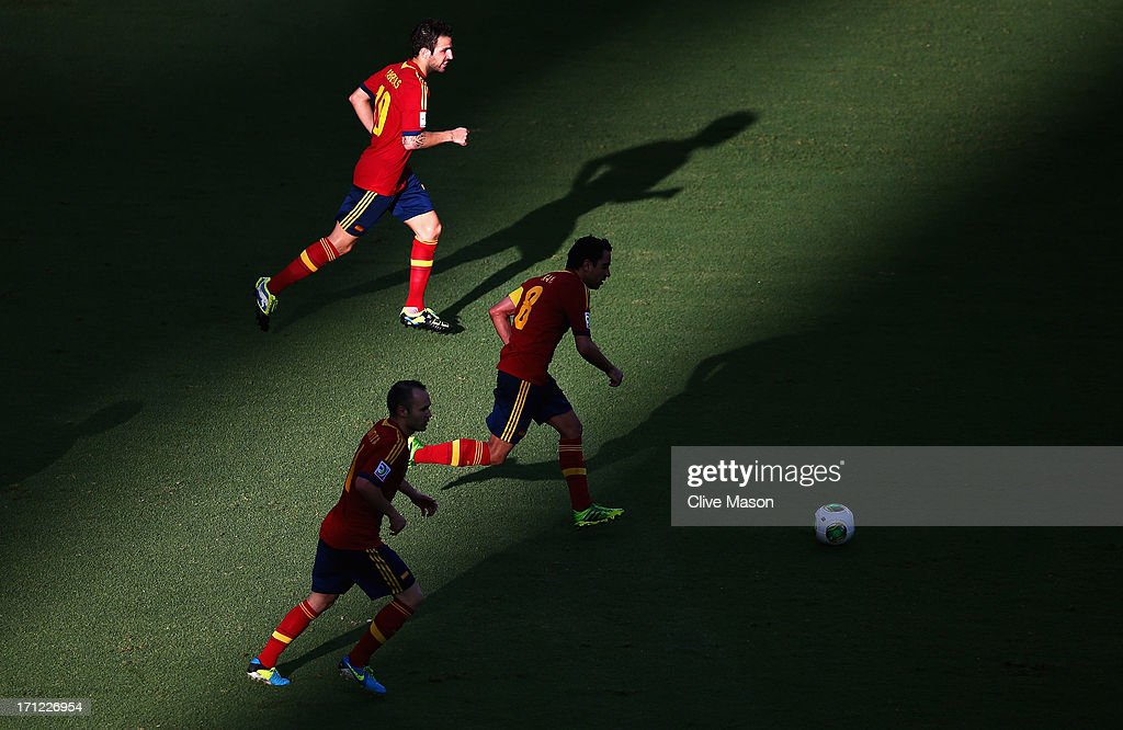 Cesc Fabregas, Xavi Hernandez and Andres Iniesta of Spain in action during the FIFA Confederations Cup Brazil 2013 Group B match between Nigeria and Spain at Castelao on June 23, 2013 in Fortaleza, Brazil.