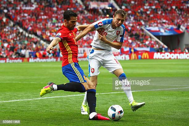 Cesc Febregas of Spain and Ladislav Krejci of Czech Republic compete for the ball during the UEFA EURO 2016 Group D match between Spain and Czech...