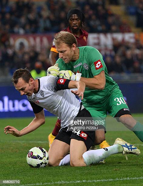 Cesena's defender Massimo Volta and Cesena's goalkeeper Federico Agliardi protect the ball as AS Roma forward of Ivory Coast Gervinho looks on during...