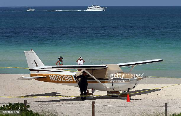 Cessna airplane is seen on the beach after its pilot made an emergency landing on July 29 2014 in Miami Beach Florida No injuries were reported to...