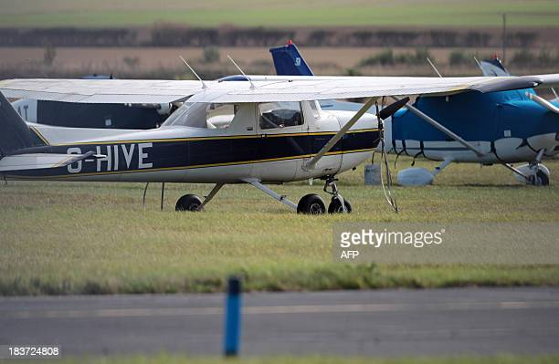 Cessna light aircraft are pictured beside the runway at Humberside airport in northeast England on October 9 2013 A passenger with no flying...