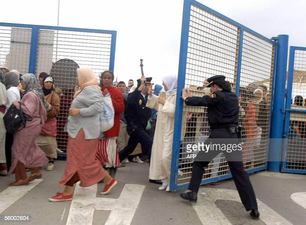 Members of the Spanish Police close the border between Spain and Morocco to hundreds of Moroccan women in Ceuta 25 October 2005 These women usually...