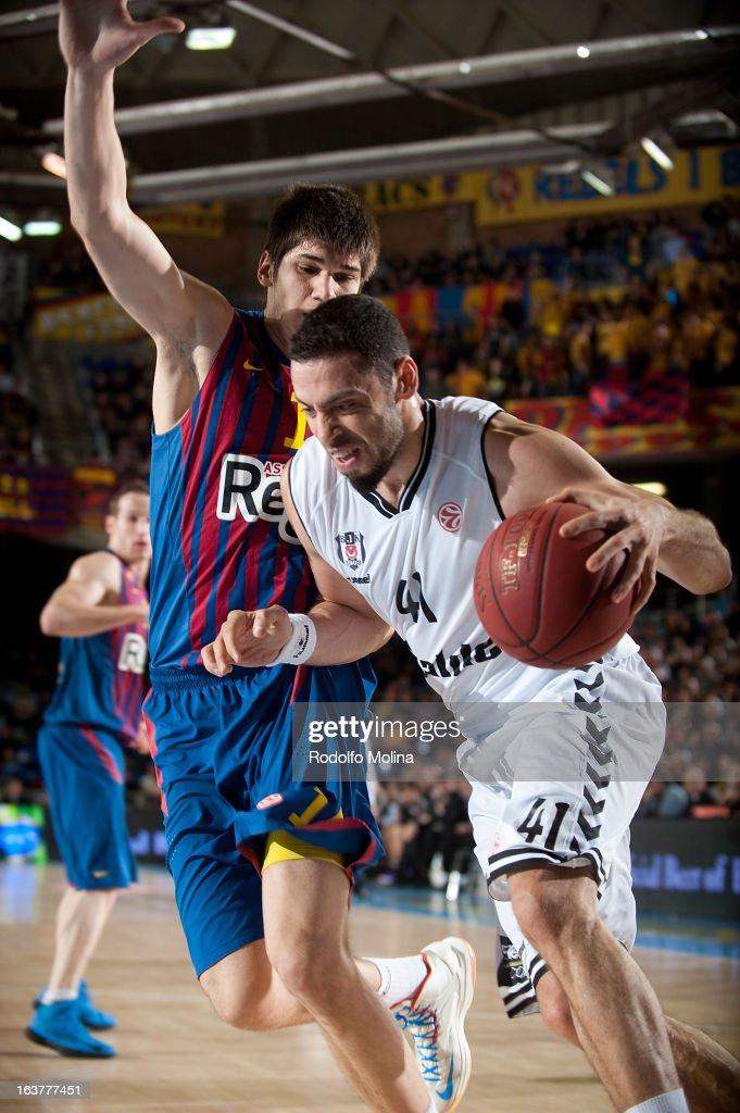Cevher Ozer, #41 of Besiktas JK Istanbul competes with Marko Todorovic, #14 of FC Barcelona Regal during the 2012-2013 Turkish Airlines Euroleague Top 16 Date 11 between FC Barcelona Regal v Besiktas JK Istanbul at Palau Blaugrana on March 15, 2013 in Barcelona, Spain.