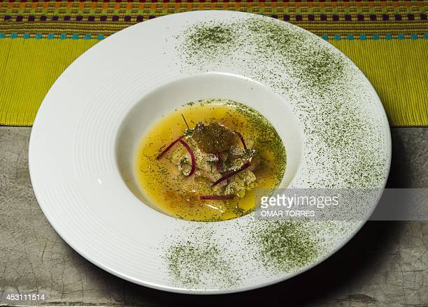 A 'ceviche' with lemon and orange juice prepared and served by chef Yiannis Rojas at his Zicanda restaurant on July 27 2014 in Oaxaca Mexico 'Mexican...