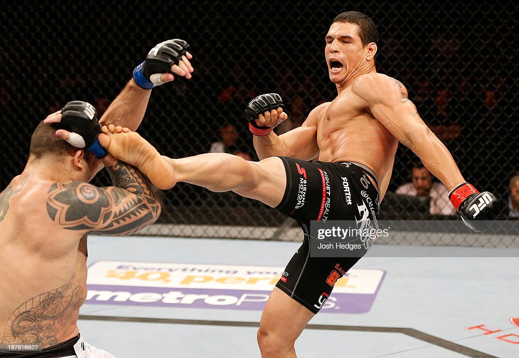 Cezar 'Mutante' Ferreira kicks Daniel Sarafian in their middleweight bout during the UFC event at Arena Goiania on November 9, 2013 in Goiania, Brazil.