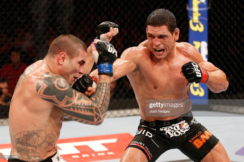 Cezar ''Mutante'' Ferreira punches Daniel Sarafian in their middleweight bout during the UFC event at Arena Goiania on November 9, 2013 in Goiania, Brazil.