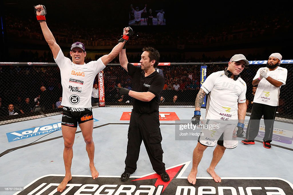 Cezar ''Mutante'' Ferreira (L) reacts after his split decision victory over Daniel Sarafian (R) in their middleweight bout during the UFC event at Arena Goiania on November 9, 2013 in Goiania, Brazil.