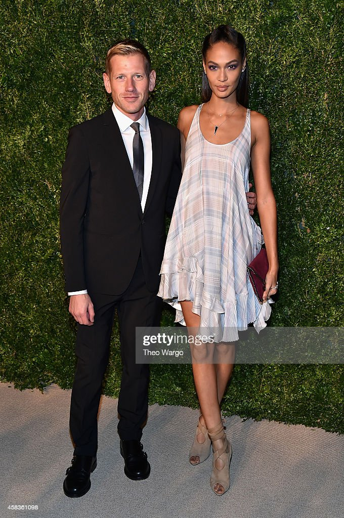 Vogue Fashion Fund winner designer Paul Andrew (L) and model Joan Smalls attend the 11th annual CFDA/Vogue Fashion Fund Awards at Spring Studios on November 3, 2014 in New York City.