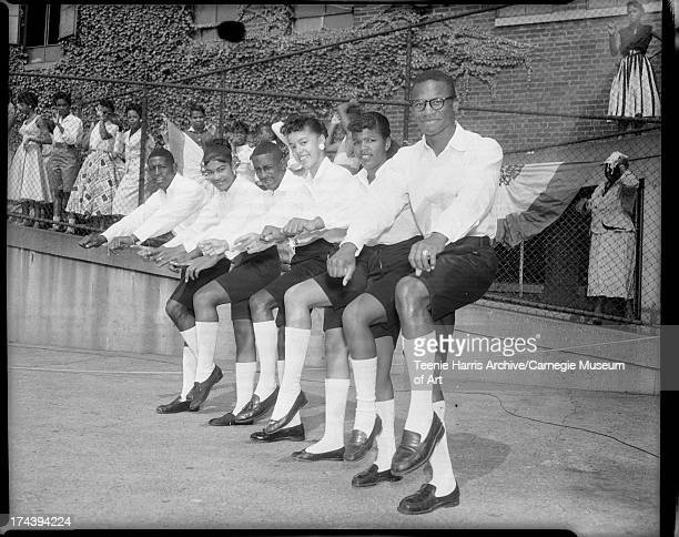 Cha cha team wearing dark Bermuda shorts and long light colored socks from left Sidney Wilson Jean Wilds Donald 'Satch' McCreary Alberta Thompson...