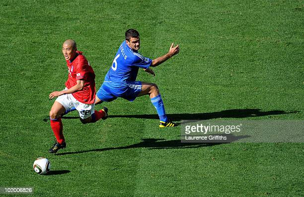 Cha DuRi of South Korea evades the challenge of Alexandros Tziolis of Greece during the 2010 FIFA World Cup South Africa Group B match between South...