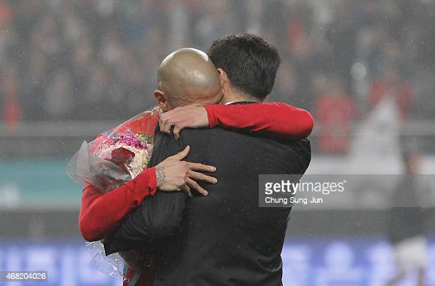 Cha DuRi of South Korea hugs his father Cha BumKun during a his farewell match between South Korea and New Zealand at Seoul World Cup Stadium on...