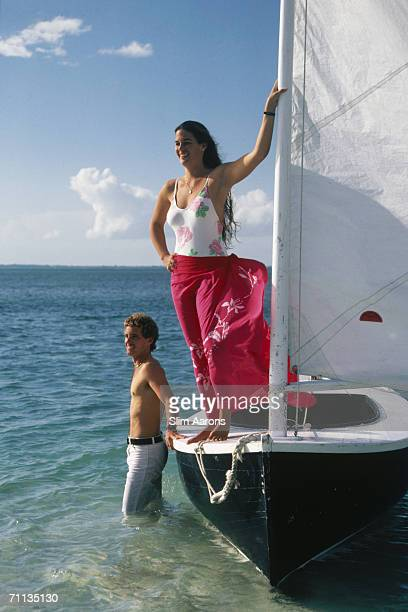 Cha Kenyon and Tim Albury enjoy the sea breeze at Elbow Cay's White Sound on the Abaco Islands of the Bahamas March 1986