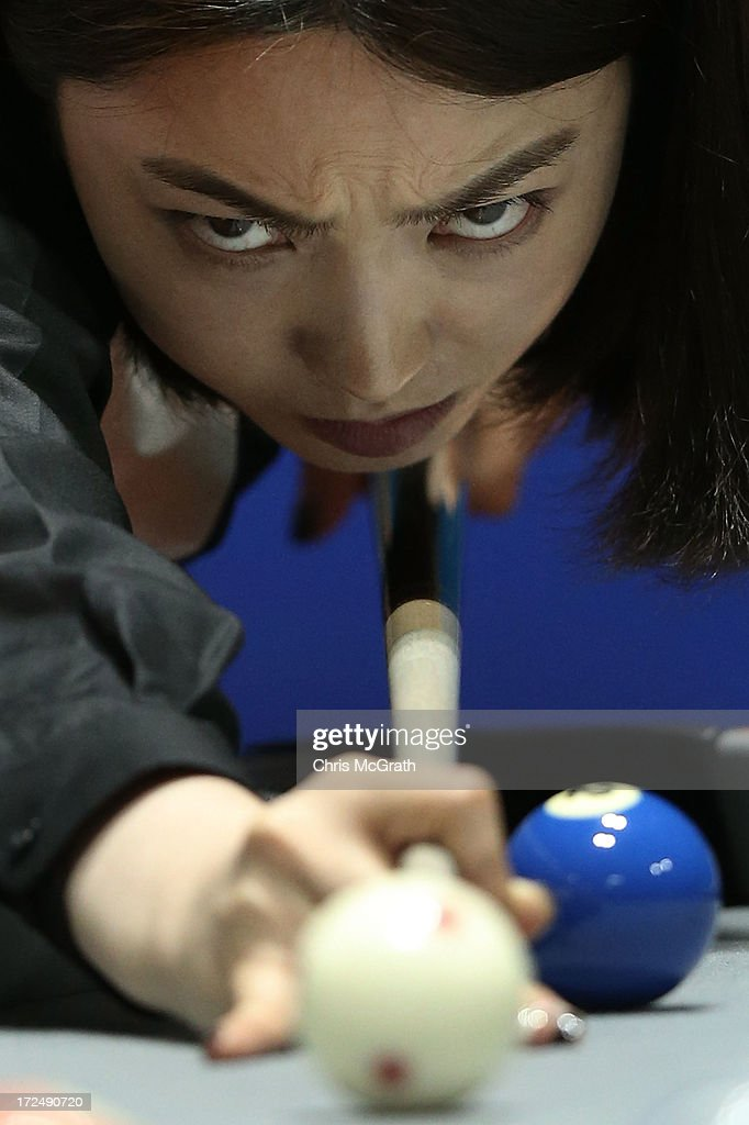 Cha Youram of Korea plays a shot against Chitchomnart Siraphat of Thailand during the Billiards, Women's 10 Ball Single Round of 32 Match at Songdo Convensia on day four of the 4th Asian Indoor & Martial Arts Games on July 2, 2013 in Incheon, South Korea.