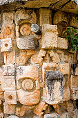 Detail of a mayan temple in Uxmal. It is the mask of chaac, god of rain and thunder.