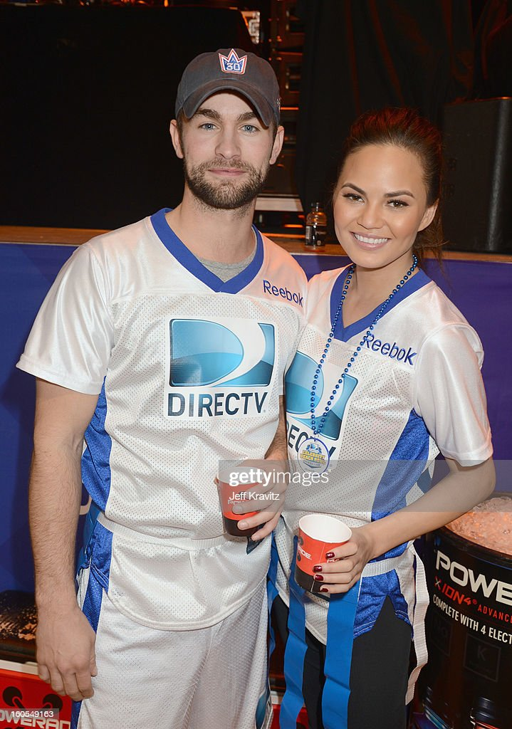 Chace Crawford and Chrissy Teigen attend DIRECTV'S 7th Annual Celebrity Beach Bowl at DTV SuperFan Stadium at Mardi Gras World on February 2, 2013 in New Orleans, Louisiana.