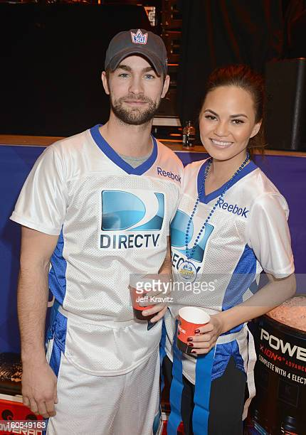 Chace Crawford and Chrissy Teigen attend DIRECTV'S 7th Annual Celebrity Beach Bowl at DTV SuperFan Stadium at Mardi Gras World on February 2 2013 in...