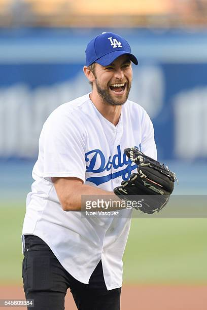 Chace Crawford throws out the ceremonial first pitch before a baseball game between the San Diego Padres and the Los Angeles Dodgers at Dodger...