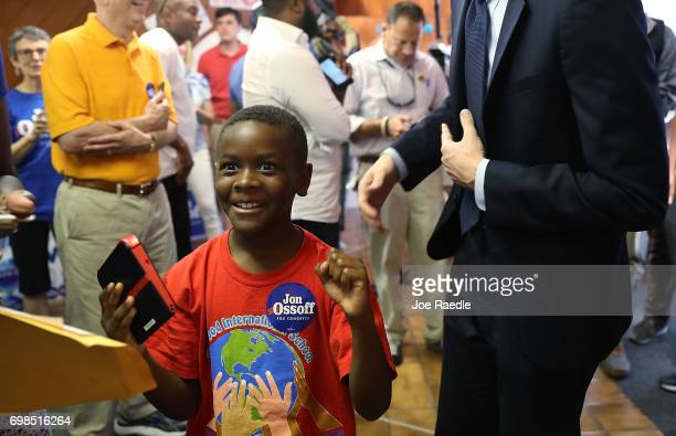 Chace Mallory reacts to meeting Democratic candidate Jon Ossoff during his visit to a campaign office on election day as he runs for Georgia's 6th...