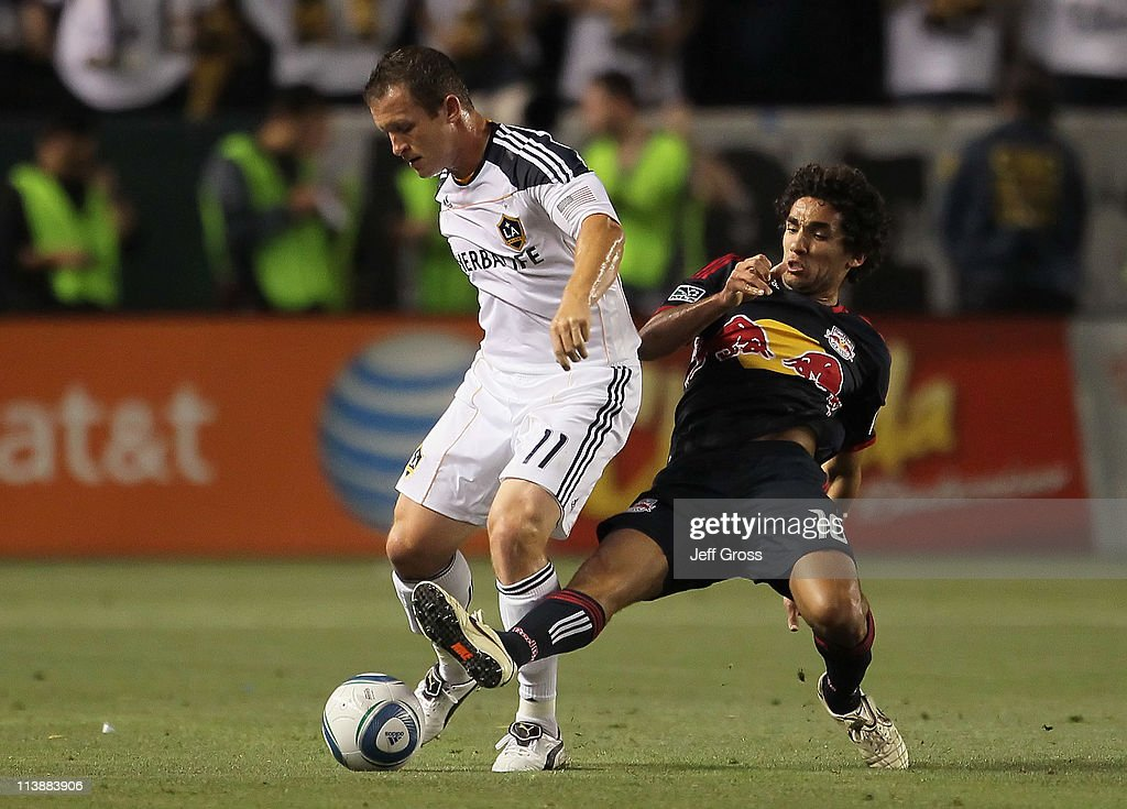 <a gi-track='captionPersonalityLinkClicked' href=/galleries/search?phrase=Chad+Barrett&family=editorial&specificpeople=753133 ng-click='$event.stopPropagation()'>Chad Barrett</a> #11 of the Los Angeles Galaxy is challenged by <a gi-track='captionPersonalityLinkClicked' href=/galleries/search?phrase=Mehdi+Ballouchy&family=editorial&specificpeople=707971 ng-click='$event.stopPropagation()'>Mehdi Ballouchy</a> #10 of the New York Red Bulls for the ball at The Home Depot Center on May 7, 2011 in Carson, California.