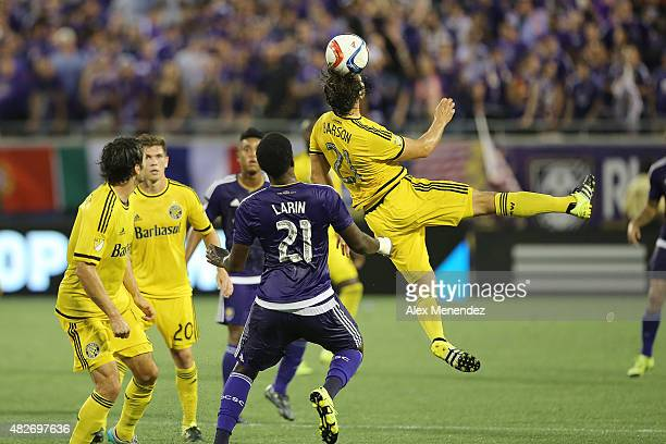 Chad Barson of Columbus Crew SC leaps to head the ball in front of Cyle Larin of Orlando City SC during a MLS soccer match between the Columbus Crew...