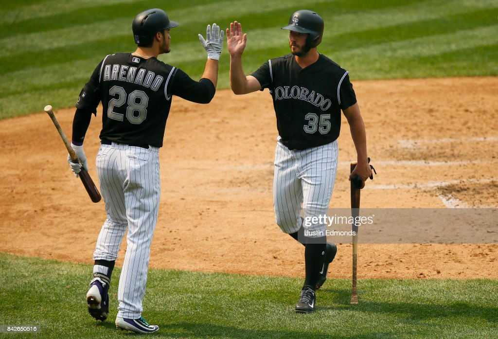 Chad Bettis #35 of the Colorado Rockies is congratulated after scoring during the fourth inning by Nolan Arenado #28 during a game against the San Francisco Giants at Coors Field on September 4, 2017 in Denver, Colorado. The Rockies defeated the Giants 4-3.