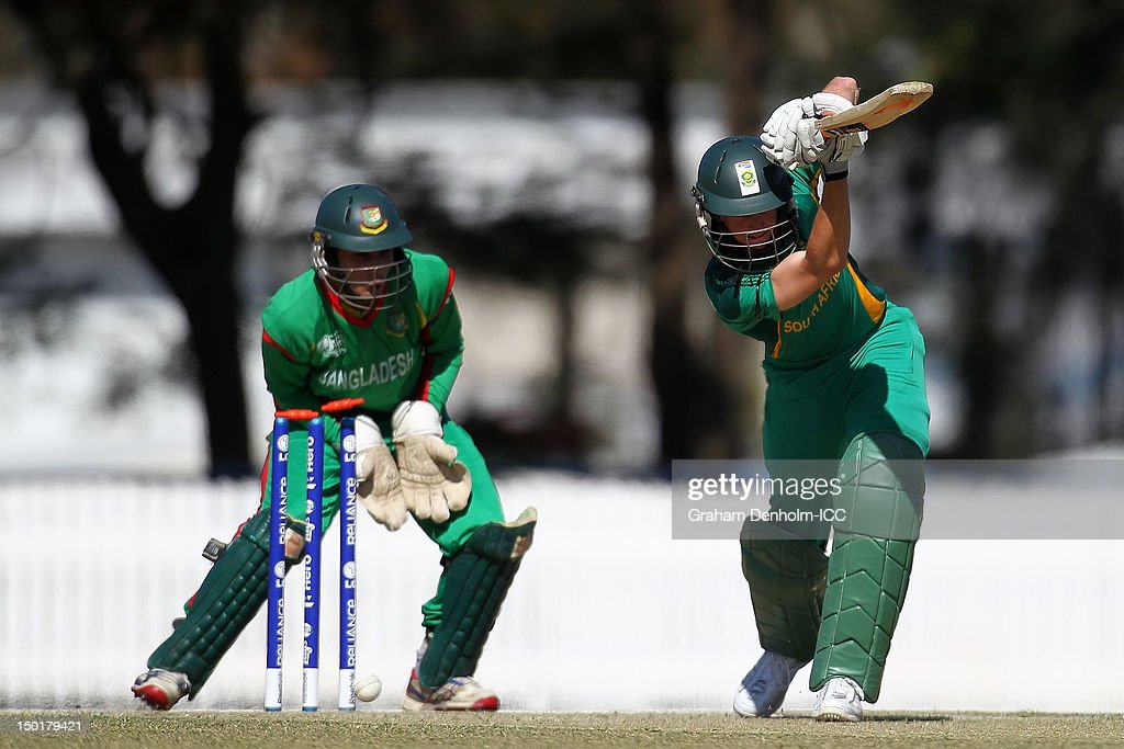 Chad Bowes of South Africa (R) is bowled out by Naeem Islam jr of Bangladesh during the ICC U19 Cricket World Cup 2012 match between South Africa and Bangladesh at Allan Border Field on August 12, 2012 in Brisbane, Australia.
