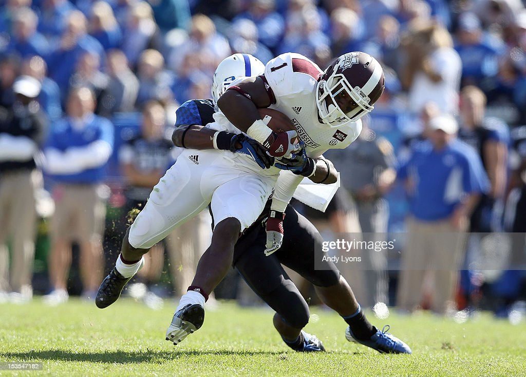 Chad Bumphis #1 of the Mississippi State Bulldogs runs with the ball while defended by Mikie Benton #31 of the Kentucky Wildcats during the SEC game at Commonwealth Stadium on October 6, 2012 in Lexington, Kentucky.