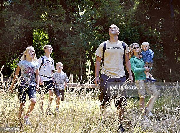 Chad center and Julie Theule second from right brought their family up from San Luis Obispo to see the redwoods in big Basin State Park where they...