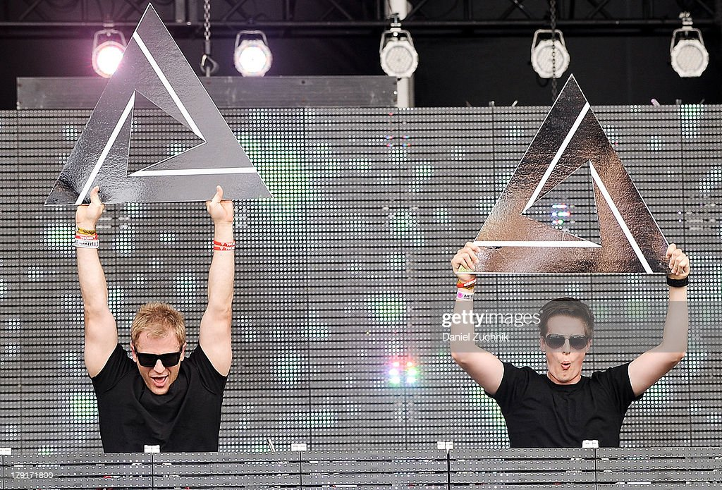 Chad Cisneros and Dave Reed of Tritonal perform during Electric Zoo 2013 at Randall's Island on August 31, 2013 in New York City.