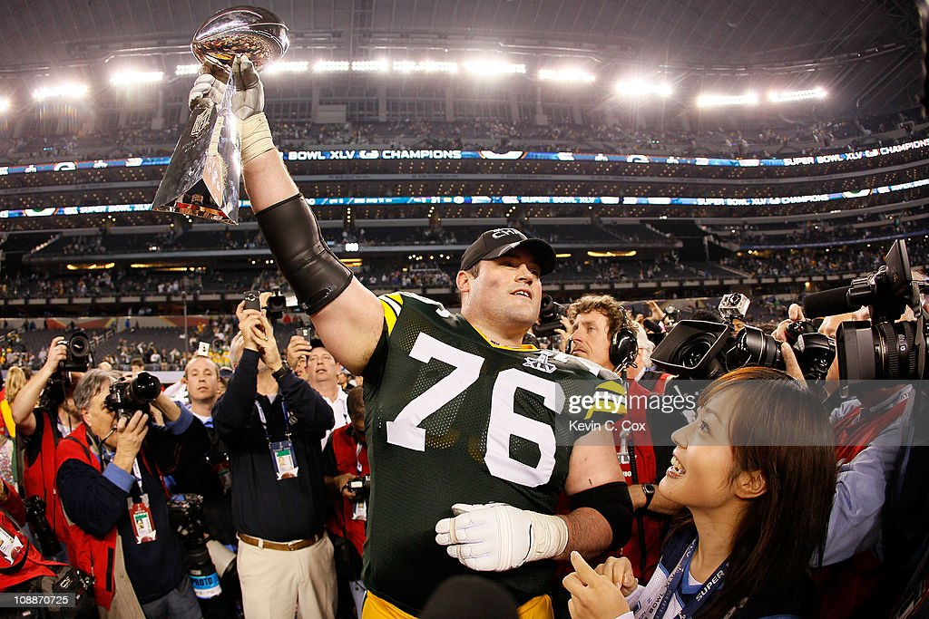 Chad Clifton #76 of the Green Bay Packers holds up the Vince Lombardi Trophy after winning Super Bowl XLV 31-25 against the at Cowboys Stadium on February 6, 2011 in Arlington, Texas.