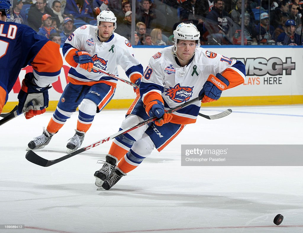 Chad Costello #18 of Team White skates after the puck during a scrimmage match between players of the New York Islanders and Bridgeport Sound Tigers on January 16, 2013 at Nassau Veterans Memorial Coliseum in Uniondale, New York.