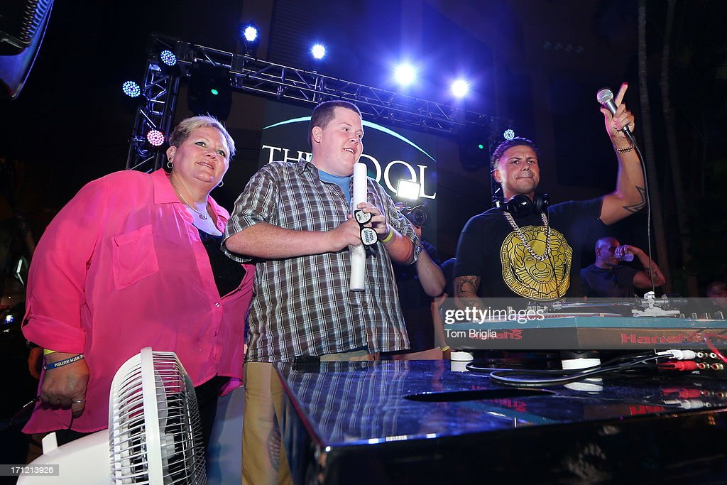 Chad DenDanto and his mother Sheri go on stage with DJ Pauly D while he performs at The Pool After Dark at Harrah's Resort on Saturday June 22, 2013 in Atlantic City, New Jersey.