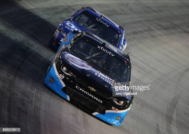 Chad Finchum driver of the Smithbilt Homes/Buddy Gregg RV Chevrolet leads a pack of cars during the NASCAR XFINITY Series Food City 300 at Bristol...