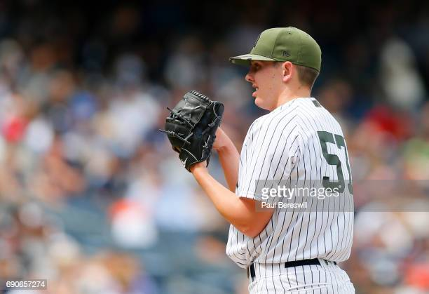 Chad Green of the New York Yankees gets set to throw a pitch in an MLB baseball game against the Oakland Athletics on May 28 2017 at Yankee Stadium...