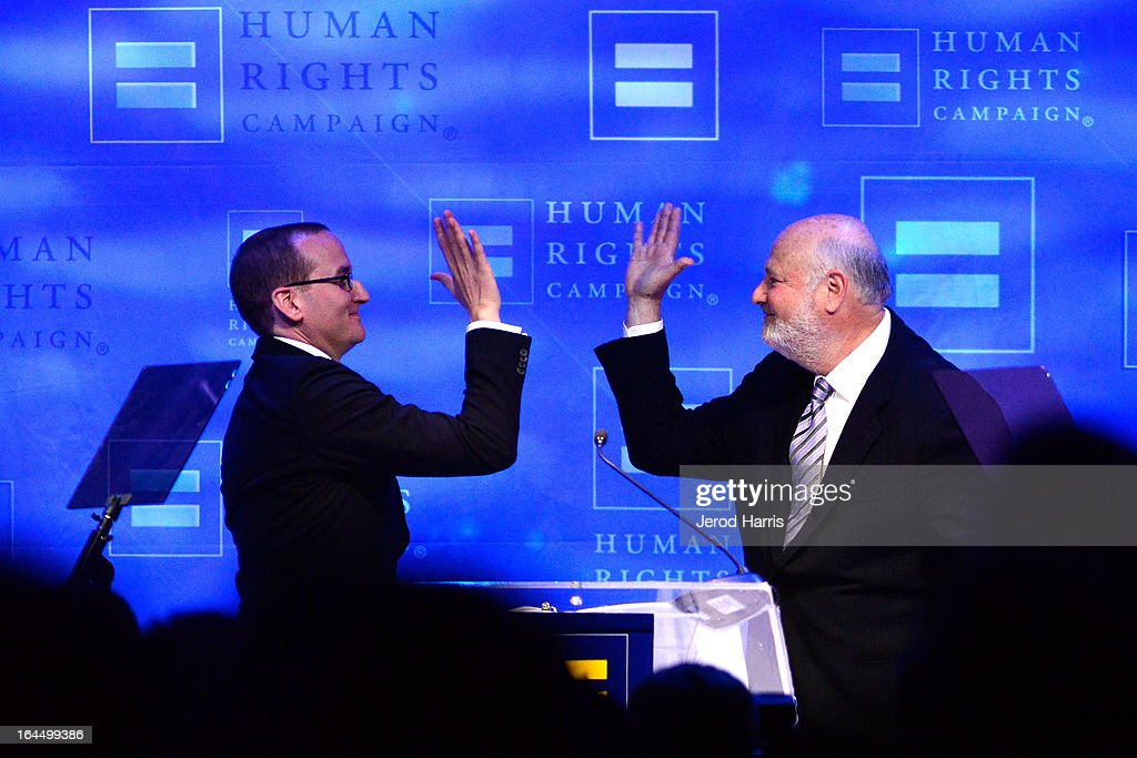 Chad Griffin President of Human Rights Campaign high fives Director <a gi-track='captionPersonalityLinkClicked' href=/galleries/search?phrase=Rob+Reiner&family=editorial&specificpeople=208749 ng-click='$event.stopPropagation()'>Rob Reiner</a> at the Human Rights Campaign dinner gala at the JW Marriott at L.A. LIVE on March 23, 2013 in Los Angeles, California.