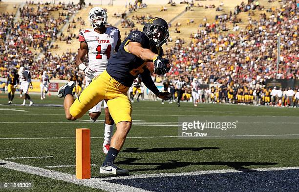 Chad Hansen of the California Golden Bears goes past Brian Allen of the Utah Utes for a touchdown at California Memorial Stadium on October 1 2016 in...