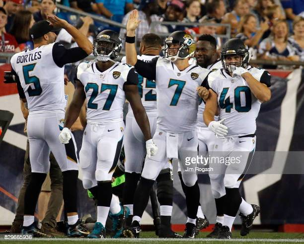Chad Henne of the Jacksonville Jaguars celebrates a touchdown against the New England Patriots in the first half at Gillette Stadium on August 10...