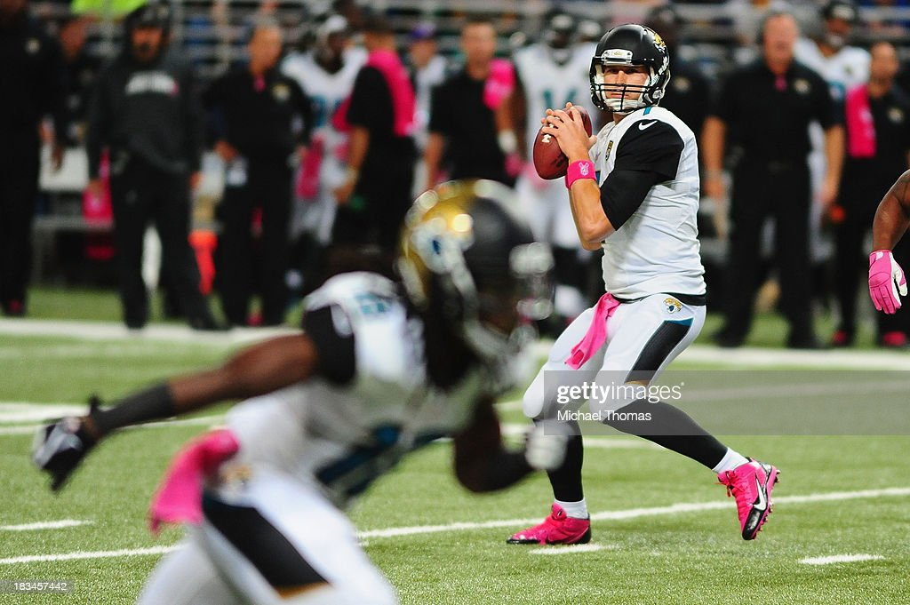 <a gi-track='captionPersonalityLinkClicked' href=/galleries/search?phrase=Chad+Henne&family=editorial&specificpeople=216361 ng-click='$event.stopPropagation()'>Chad Henne</a> #7 of the Jacksonville Jaguars drops back to pass against the St. Louis Rams at the Edward Jones Dome on October 6, 2013 in St. Louis, Missouri.