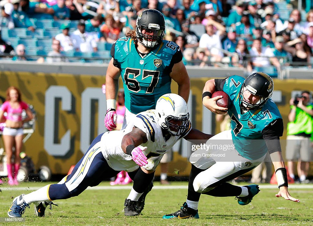 Chad Henne of the Jacksonville Jaguars is sacked by Larry English of the San Diego Chargers during the game at EverBank Field on October 20 2013 in...