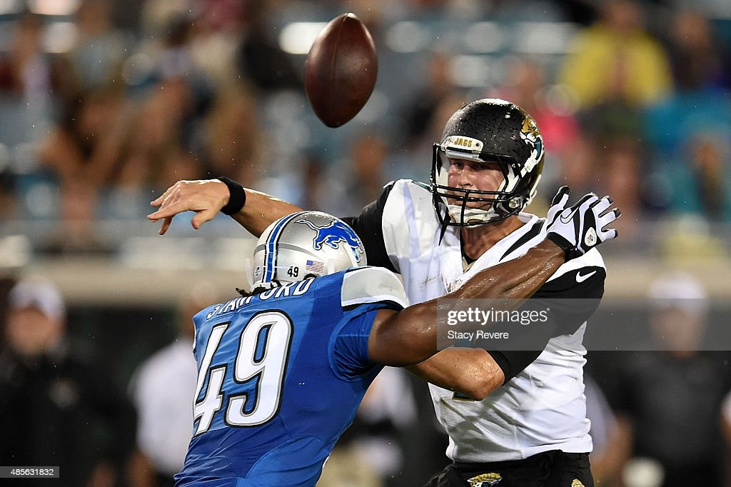 Chad Henne of the Jacksonville Jaguars loses the ball after being hit by Julian Stanford of the Detroit Lions during the third quarter of a preseason...